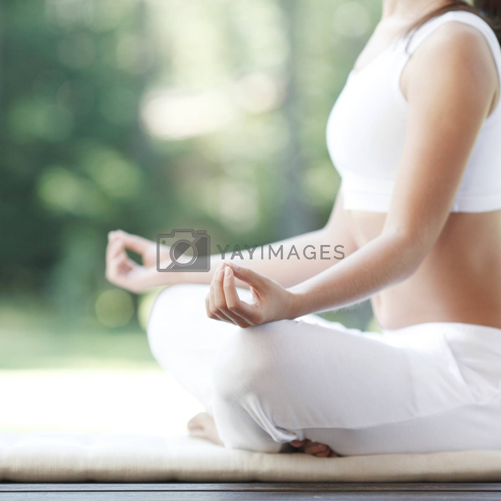 Woman practicing yoga by ALotOfPeople