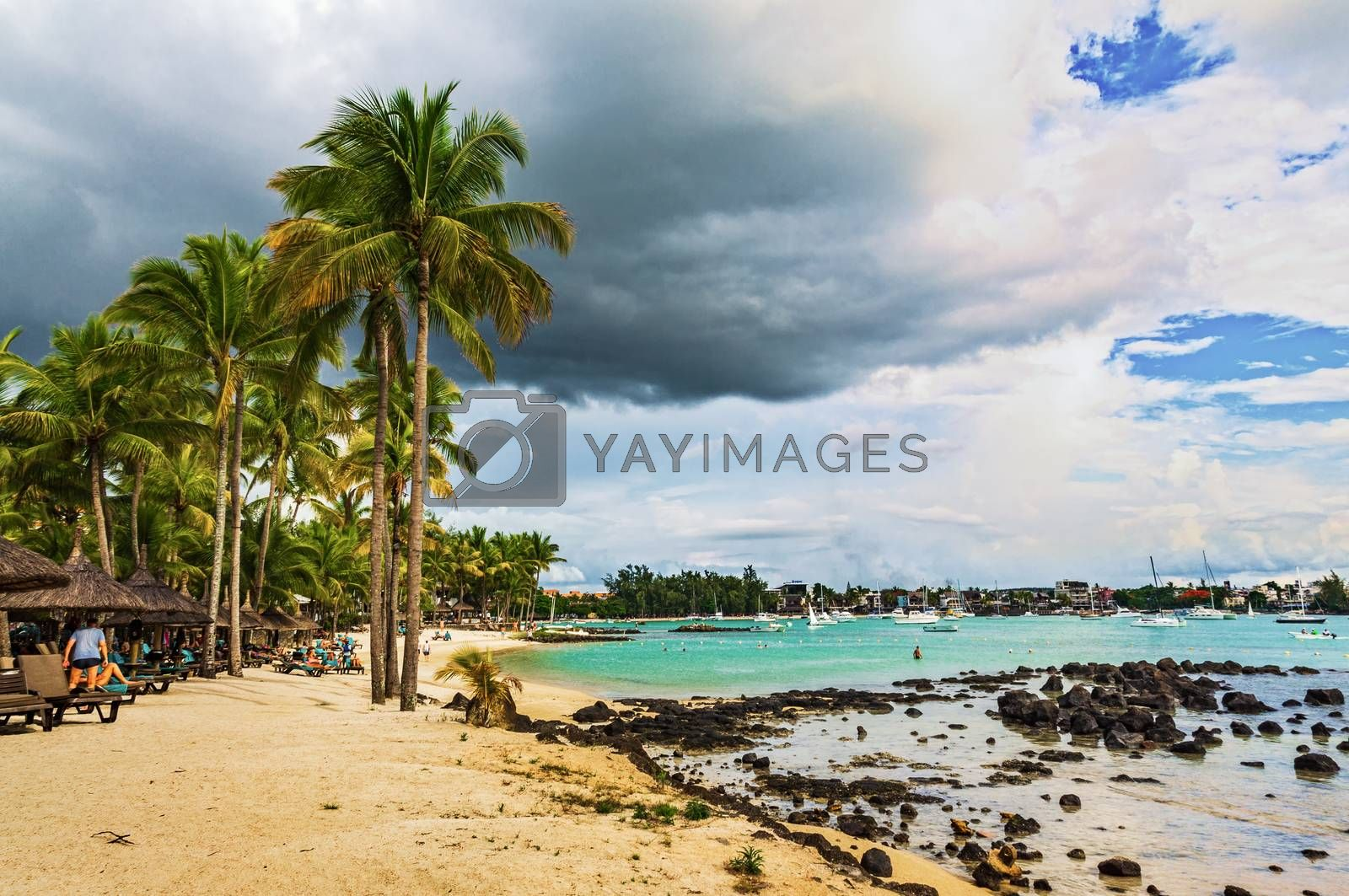 Sea beach with boats and yachts on the water and black stones by VladimirZubkov