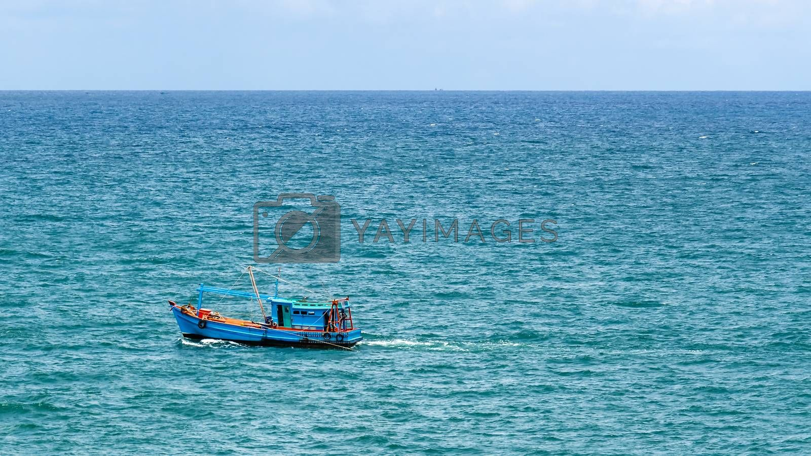 Blue fishing boat traveling along the Gulf of Thailand by Julia Chan