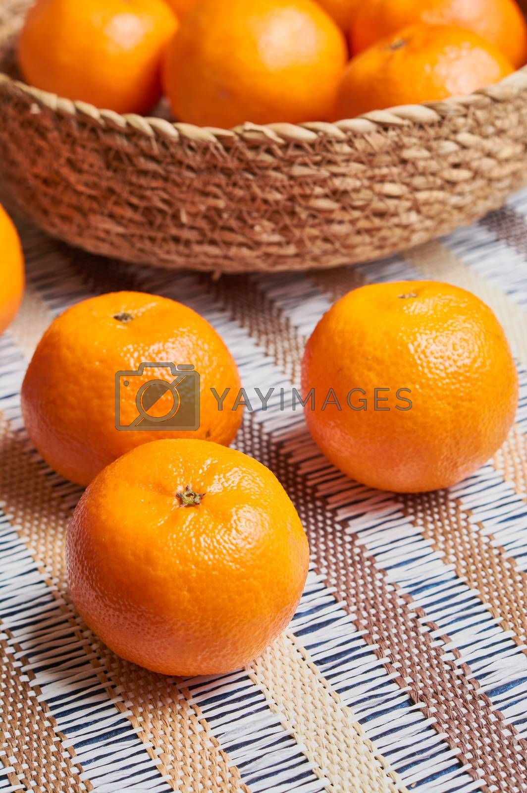tangerine basket with artisan tablecloth background by Prf_photo