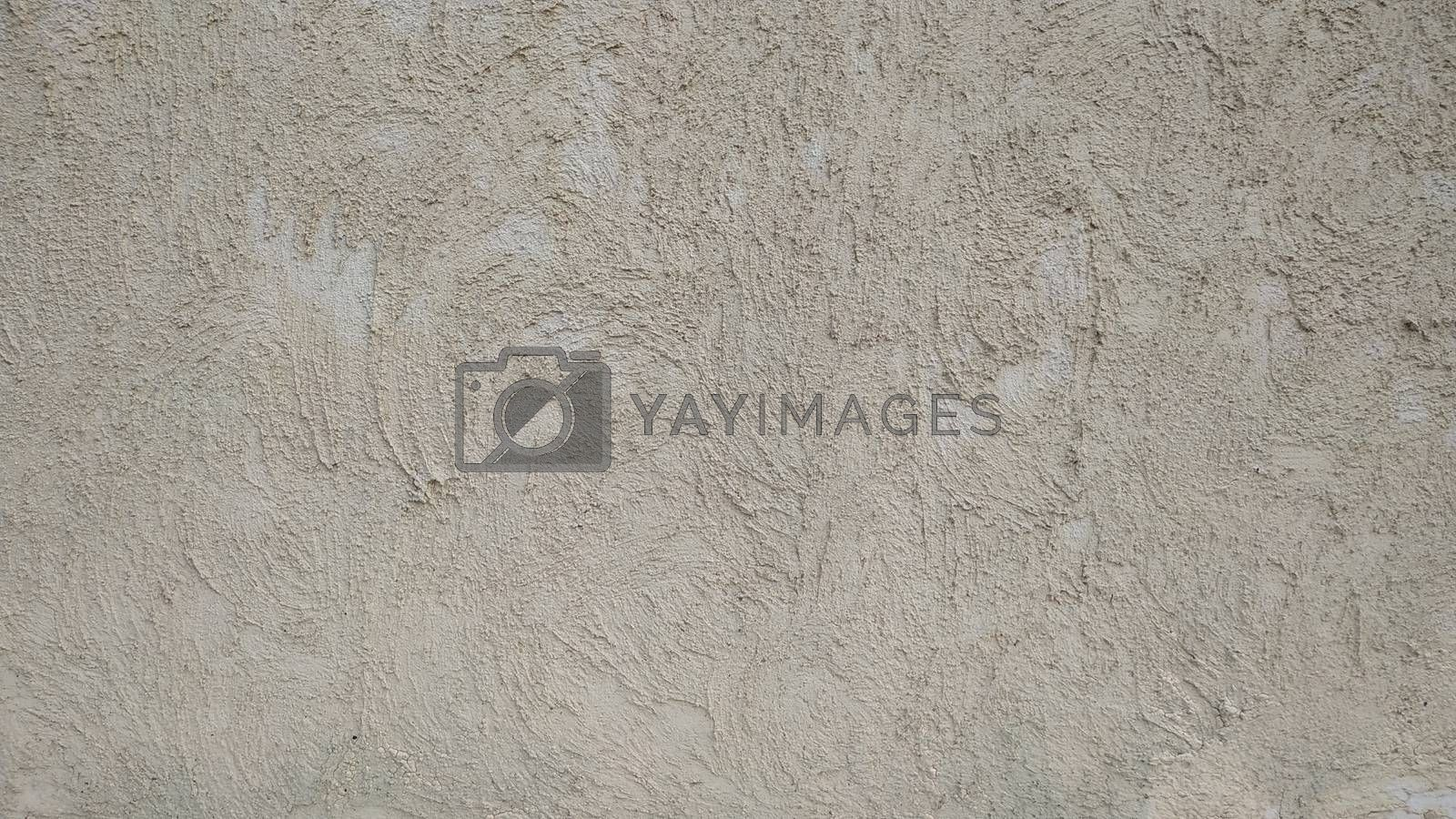 Wall covered with coarse cement gray plaster. Background.