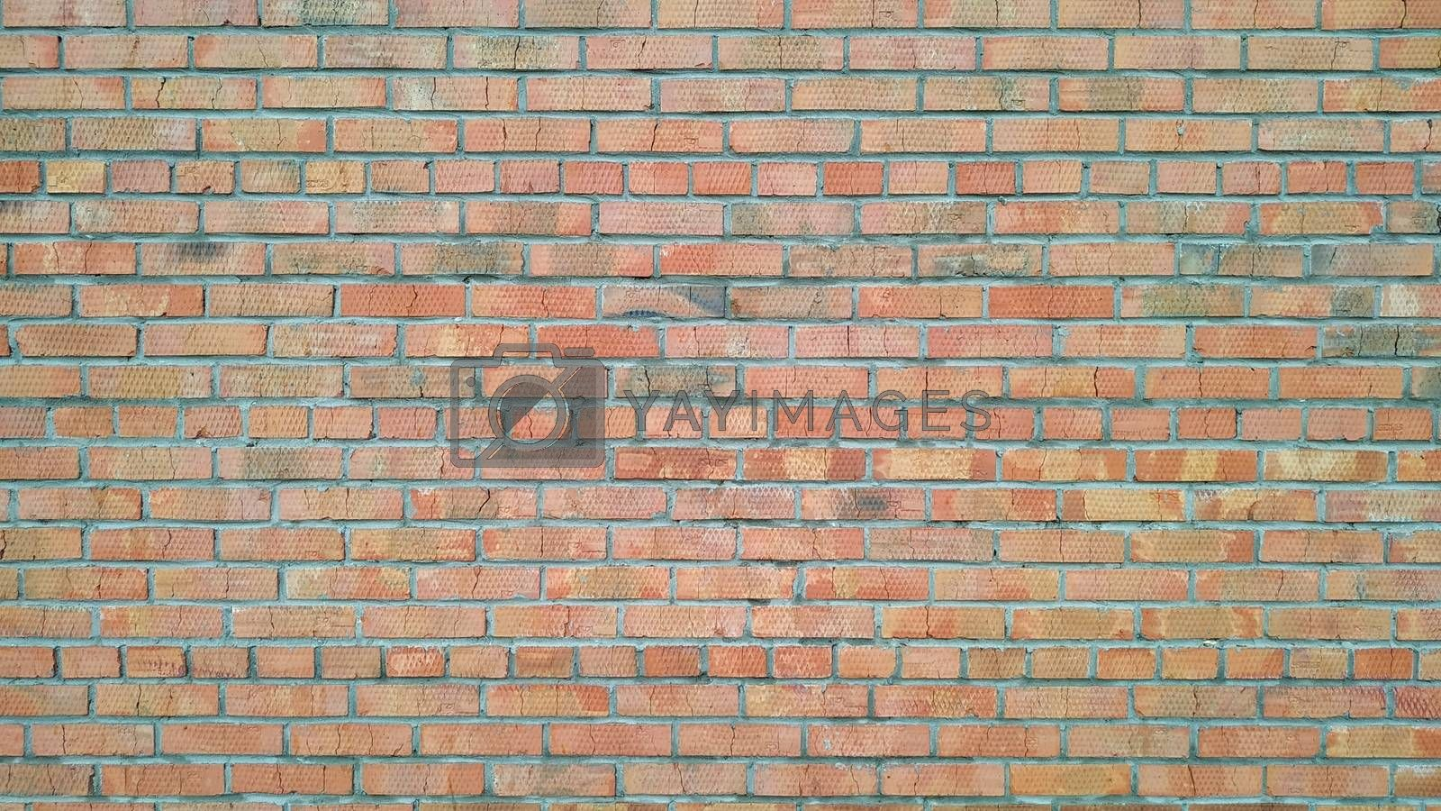 Old bricks wall, taken in the street on a cloudy day close-up. Background. Texture.
