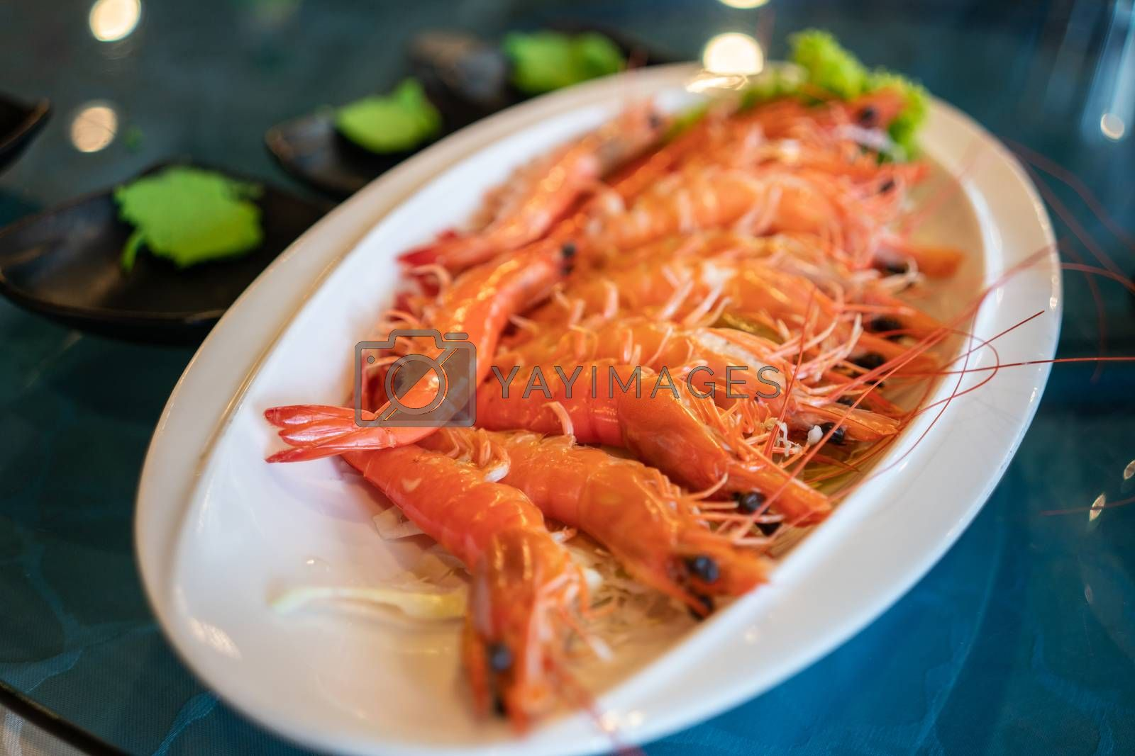 Royalty free image of A Plate of Cooked Prawn in a Restaurant by kstphotography