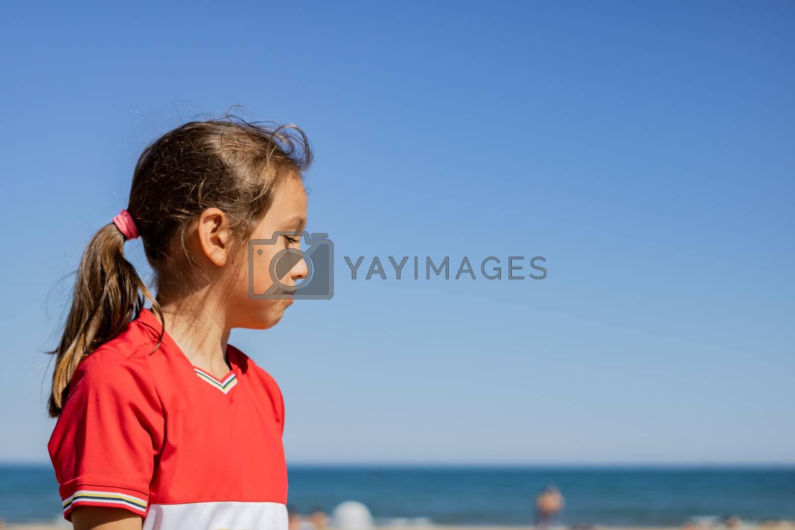 Little girl posing on the beach by Barriolo82