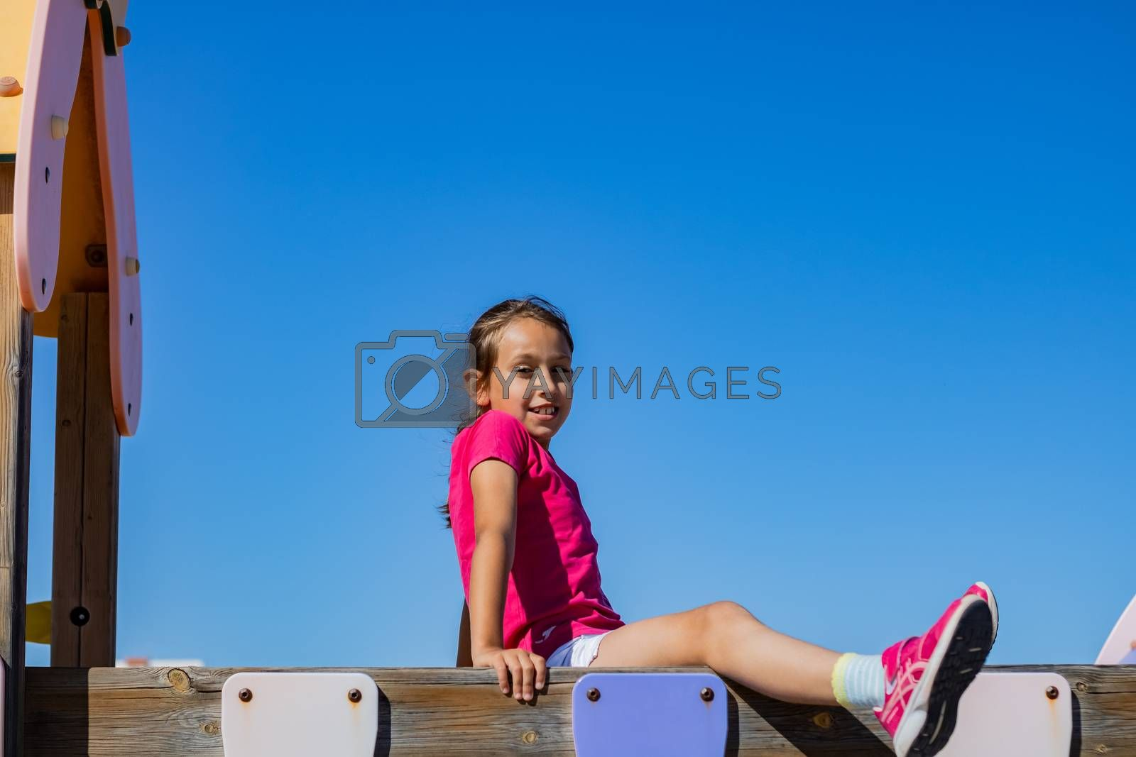 Little girl playing in a playground by Barriolo82