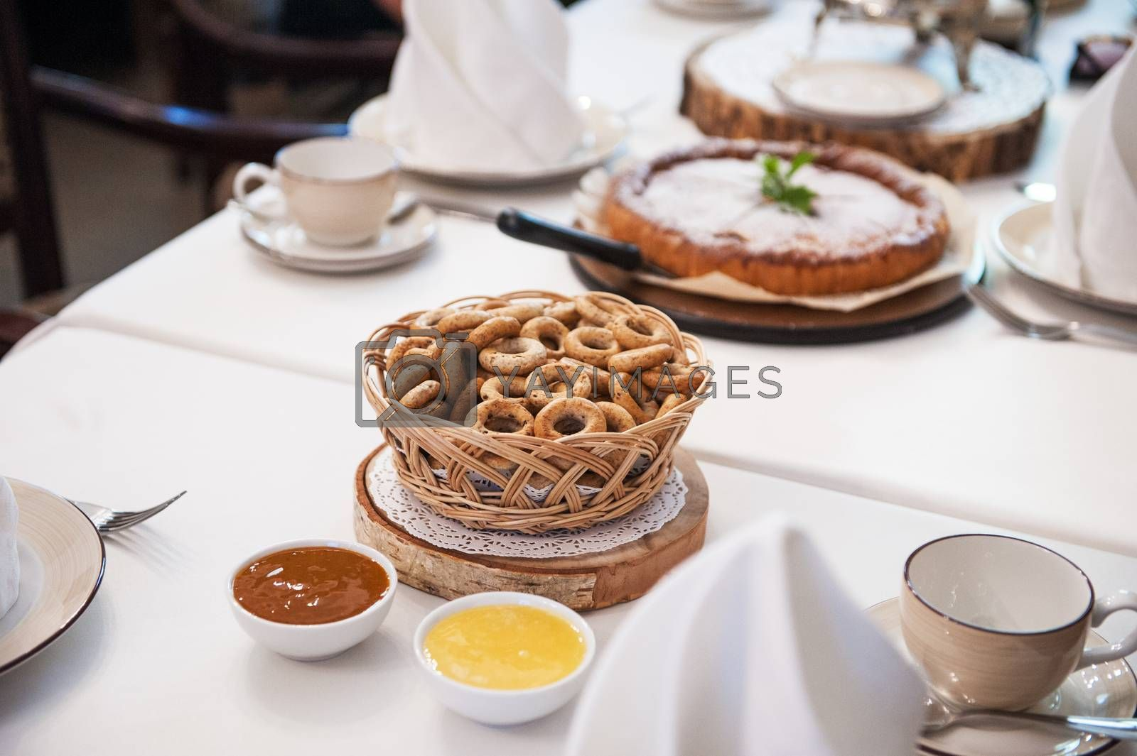 Traditional russian baked goods: pies and pretzels, samovar, honey, jam on the served table
