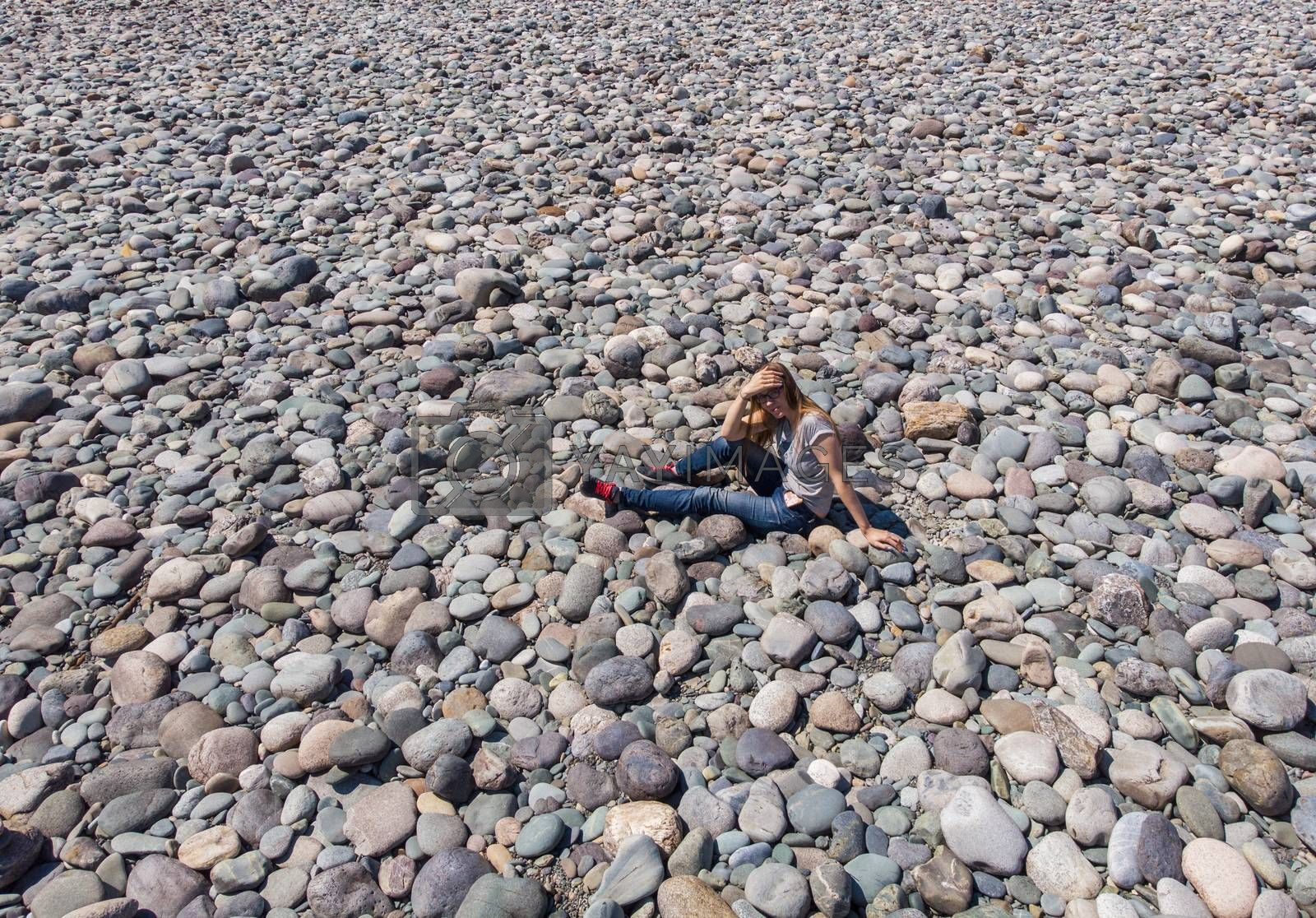 Aerial view of Katun stones riverbank, in Altai mountains, woman lying on the stones in beauty day.