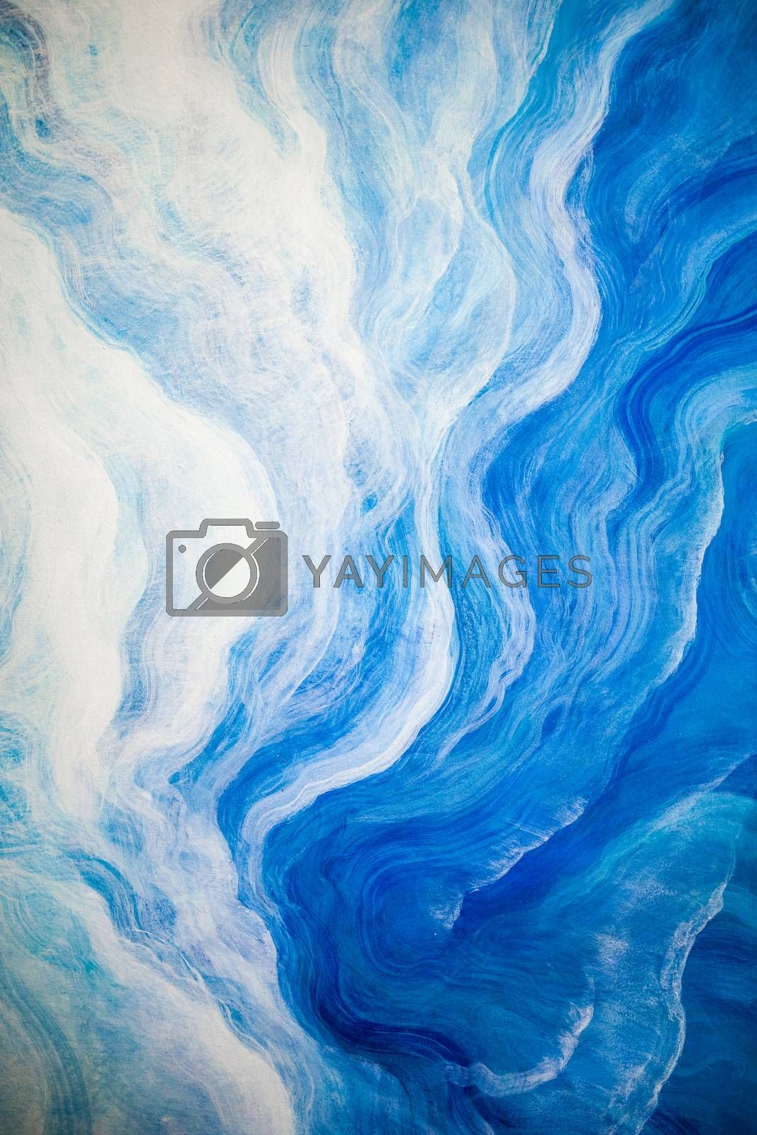 Vertical scene of abstract background of white and blue wave painted on wall.
