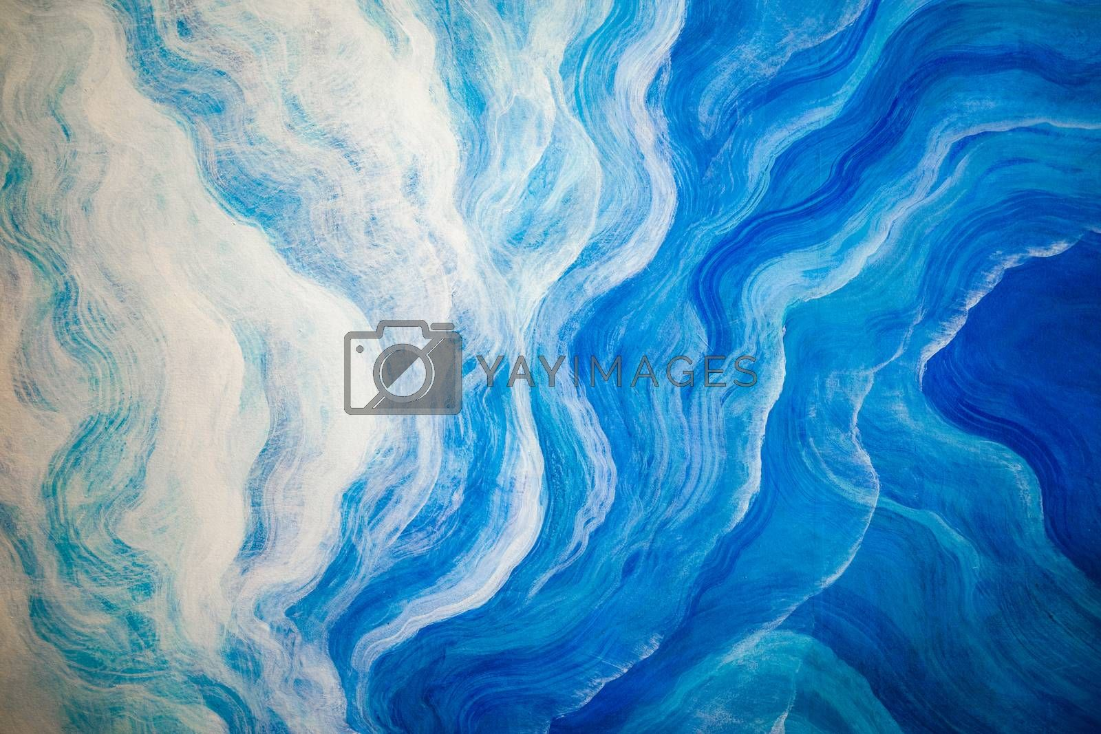 Abstract background of white and blue wave painted on wall.
