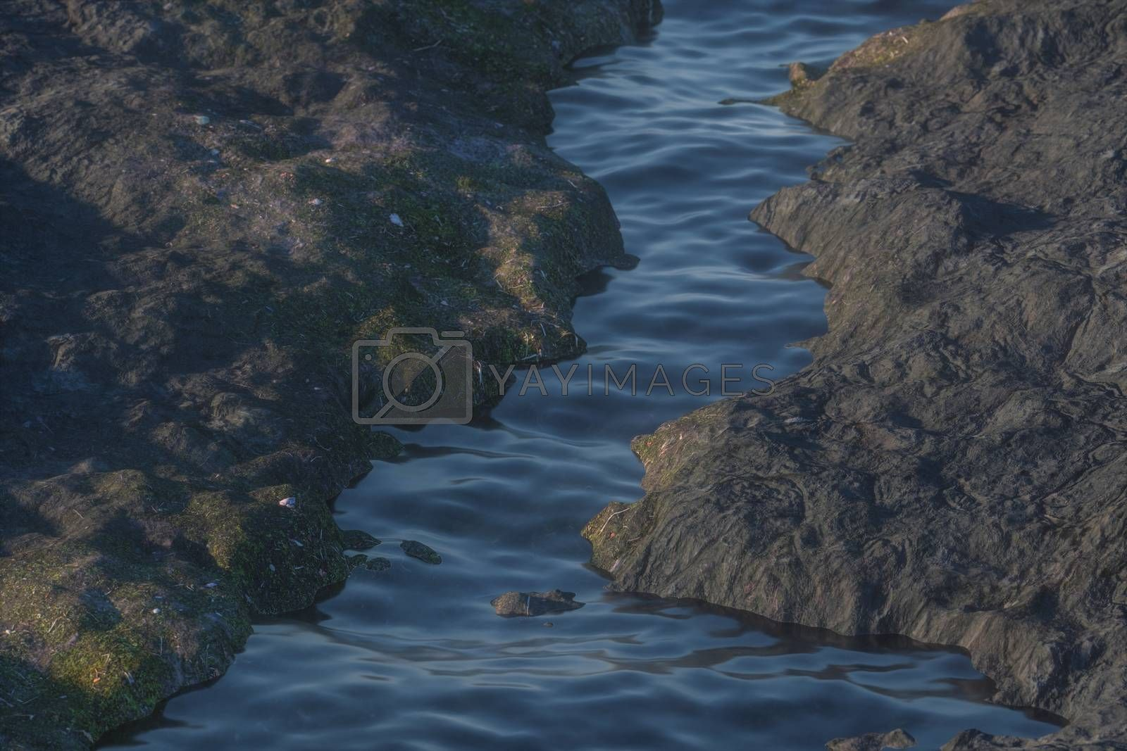 The river between the mountains in a sunny day, 3d rendering by vinkfan