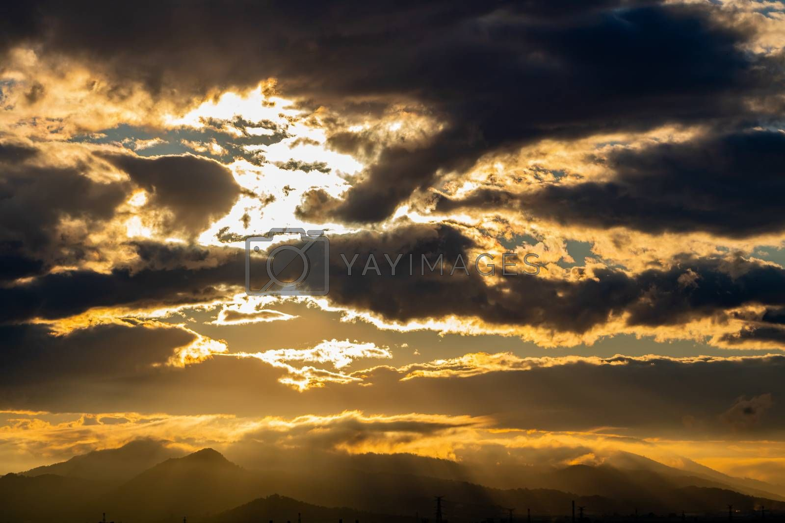 Sunset over mountains with storms clouds
