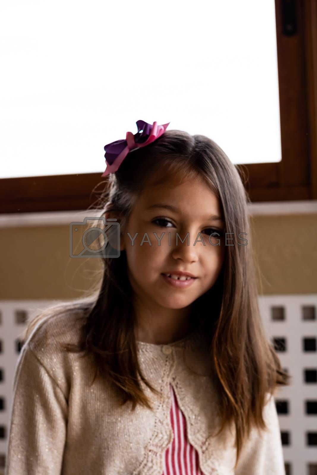 Portrait of little girl posing smiling