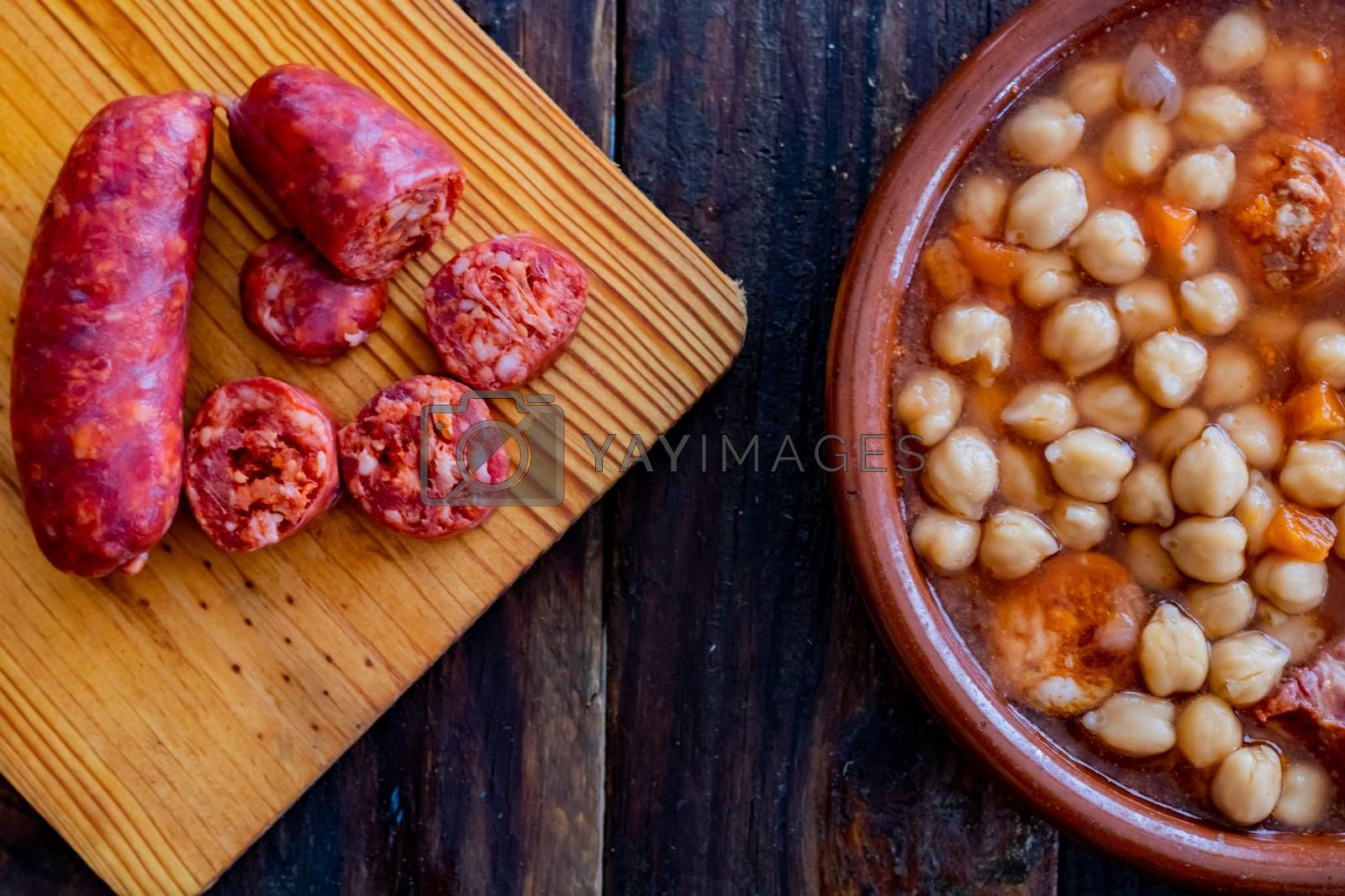 Chickpea dish and ingredients in composition on wooden background