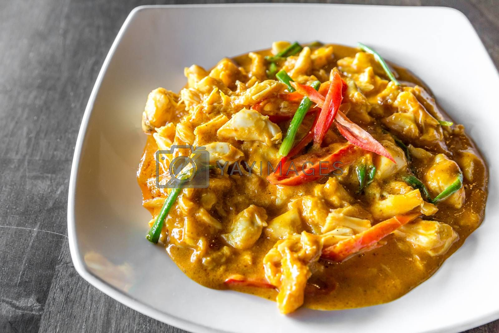 Chili Crab meat fried with curry in Thai style cuisine food