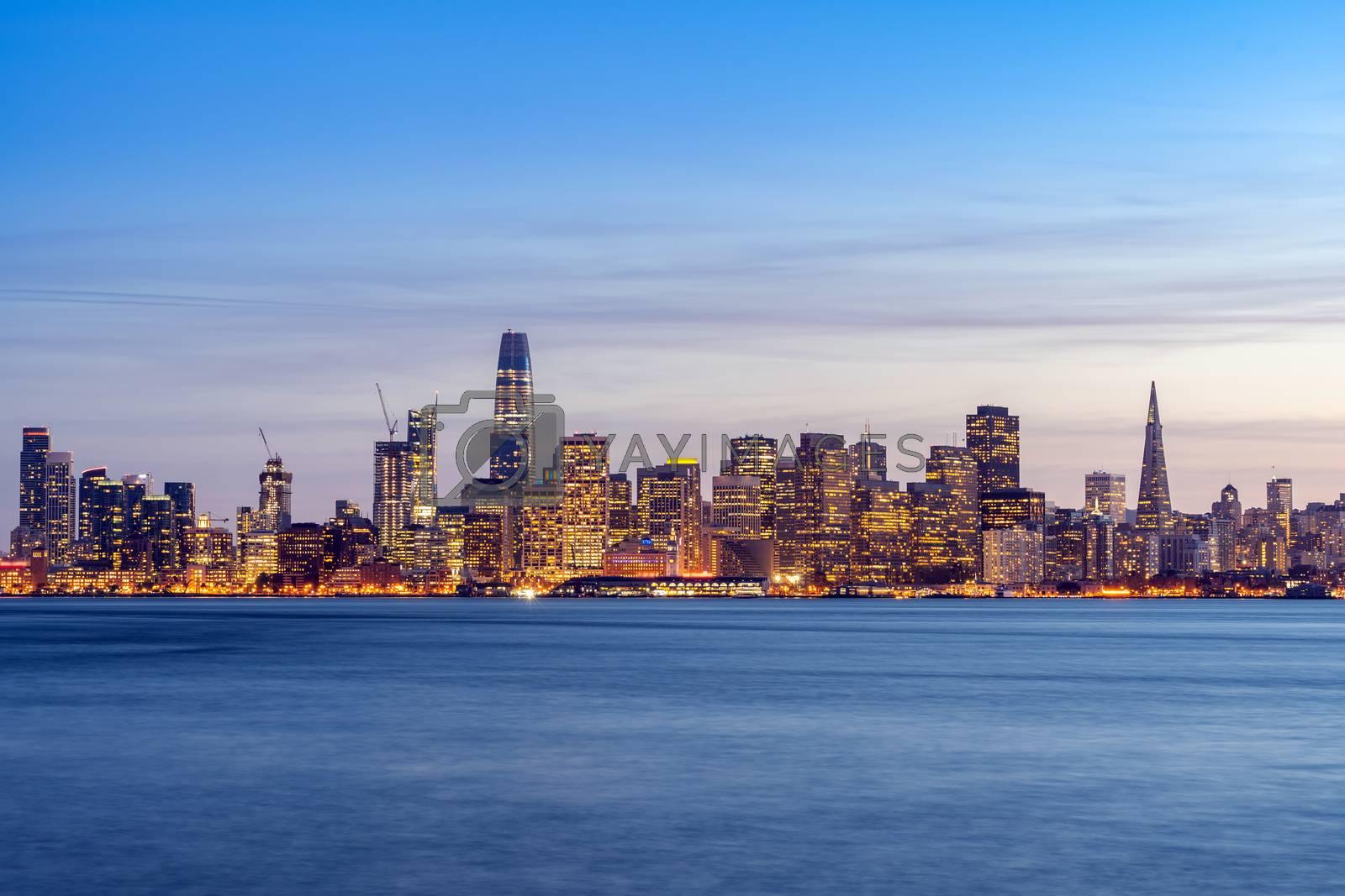 San Francisco downtown skyline at dusk from Treasure Island, California, sunset, USA.