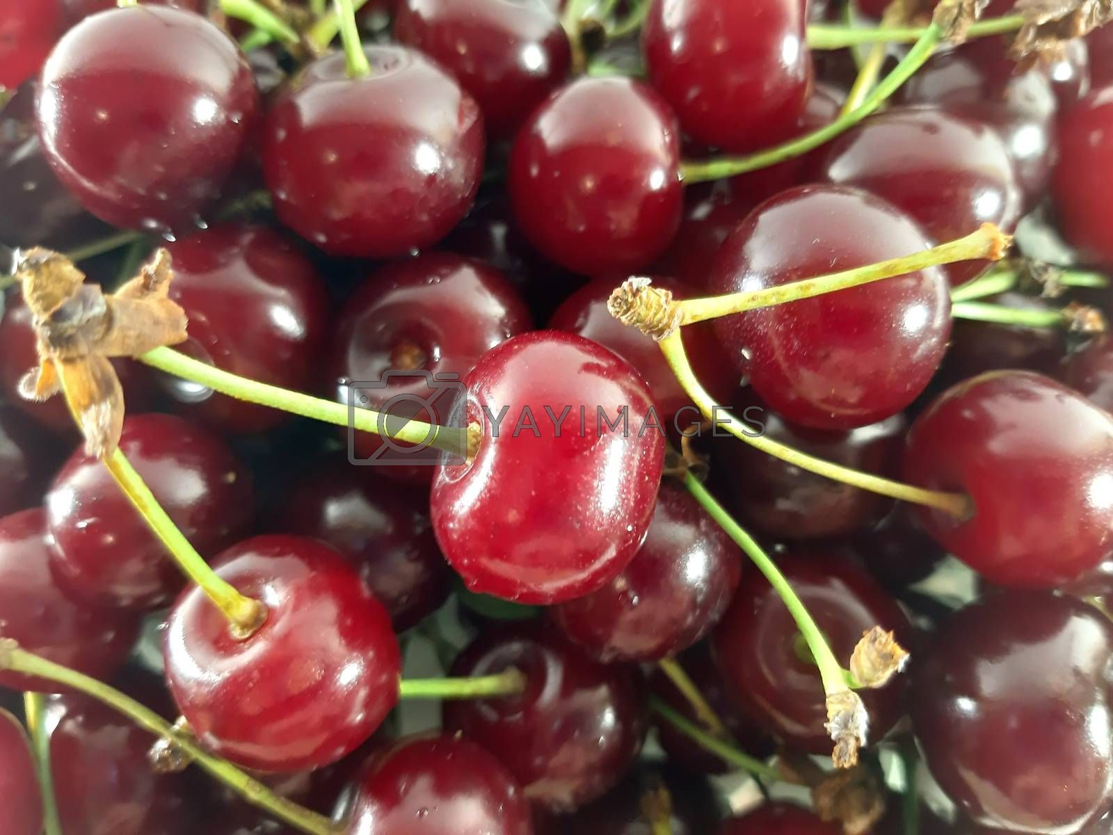 Background red cherry . Photo healthy food. Vegetarian red food. Berries and fruits. Berry for snack.