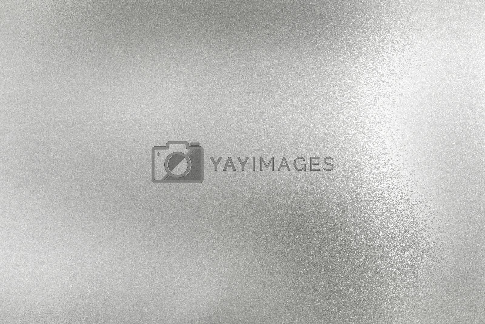 Glowing silver foil metal wall surface, abstract texture background