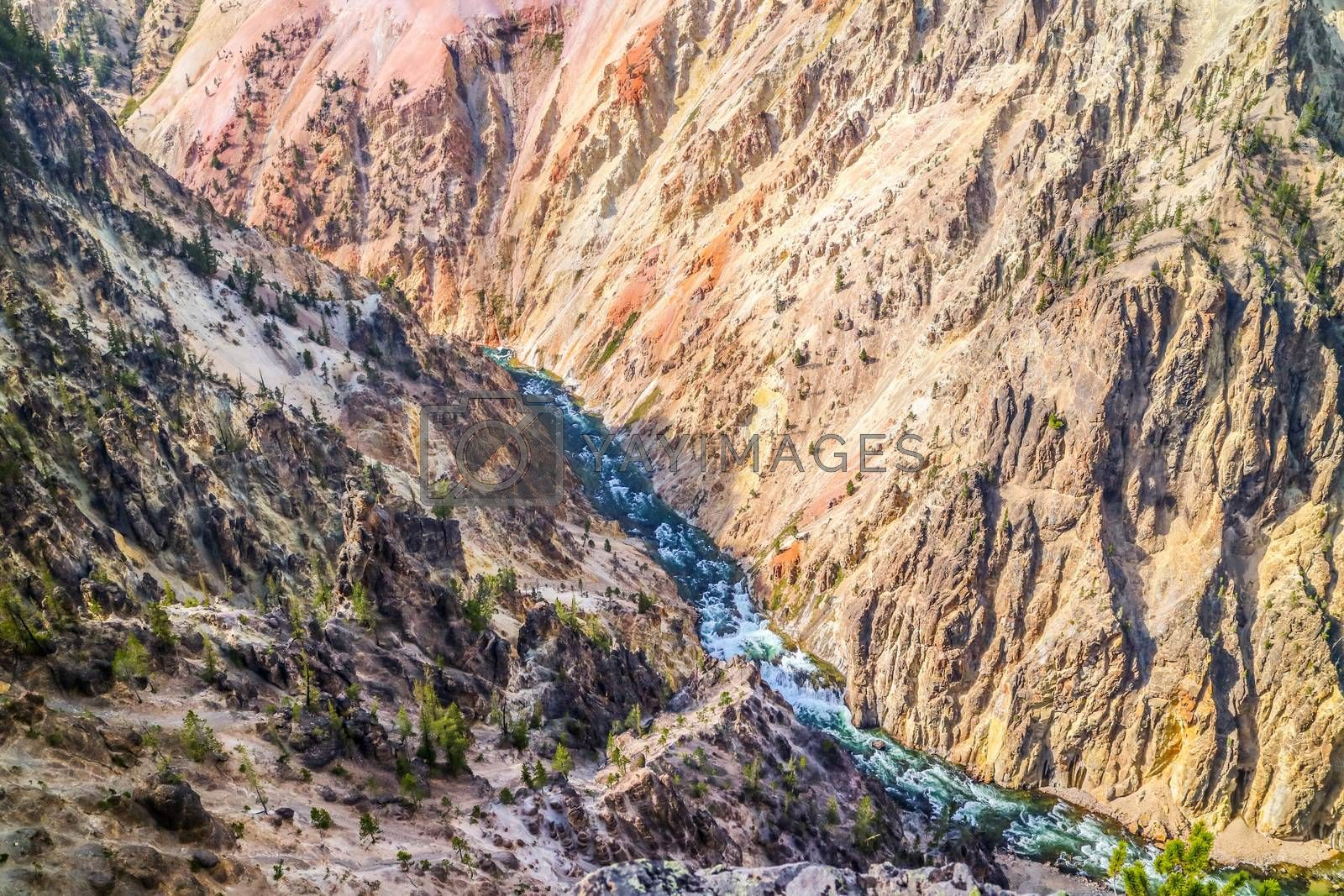 An epic scenery of the canyon in between of those large mountain ranges