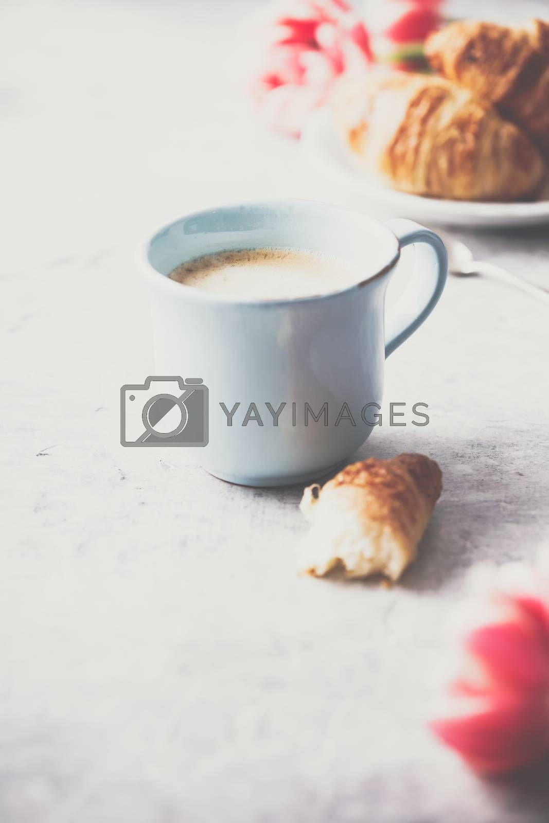Morning coffee, croissants and spring tulips on light grey backg by klenova