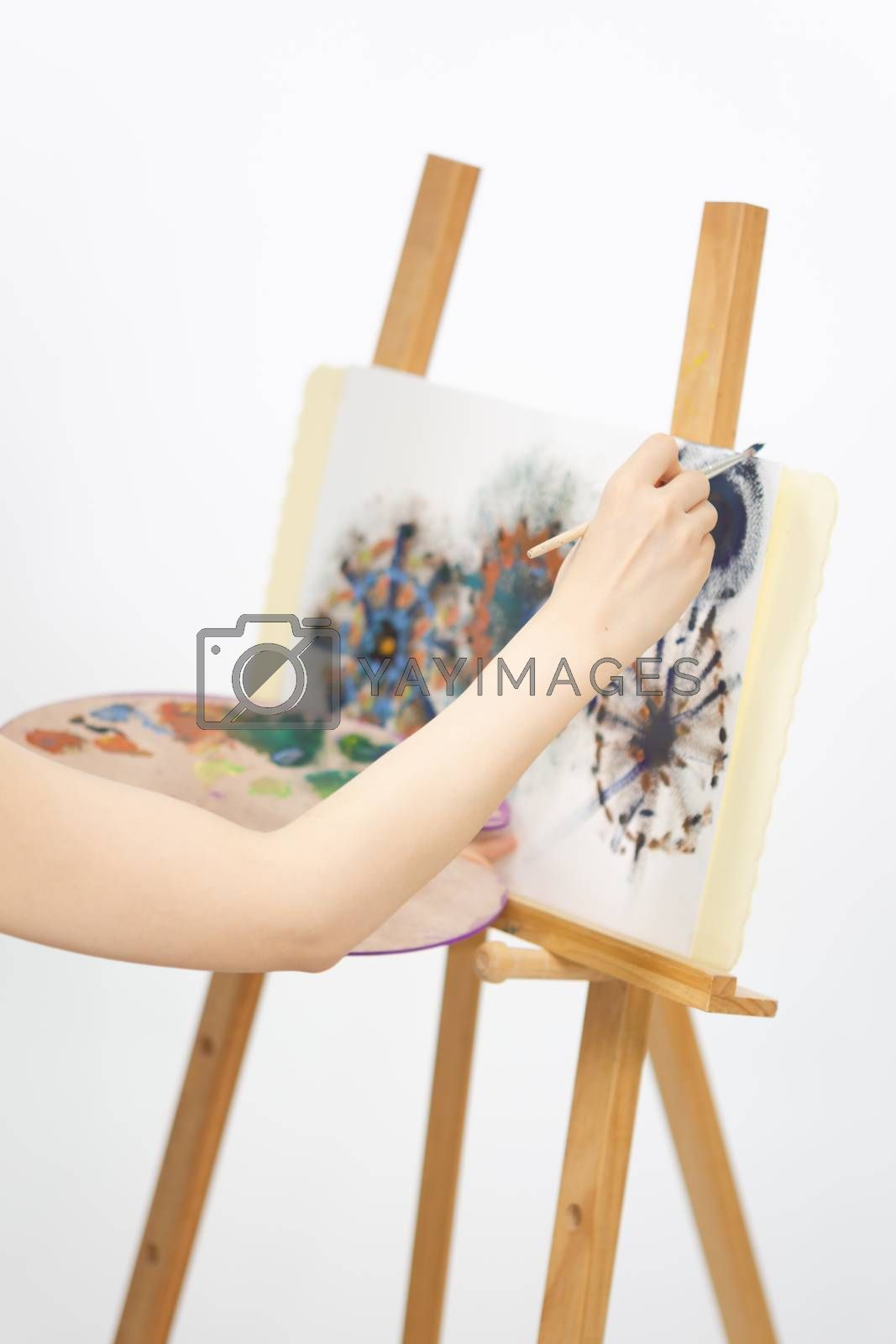 Close up of artist painting on an easel