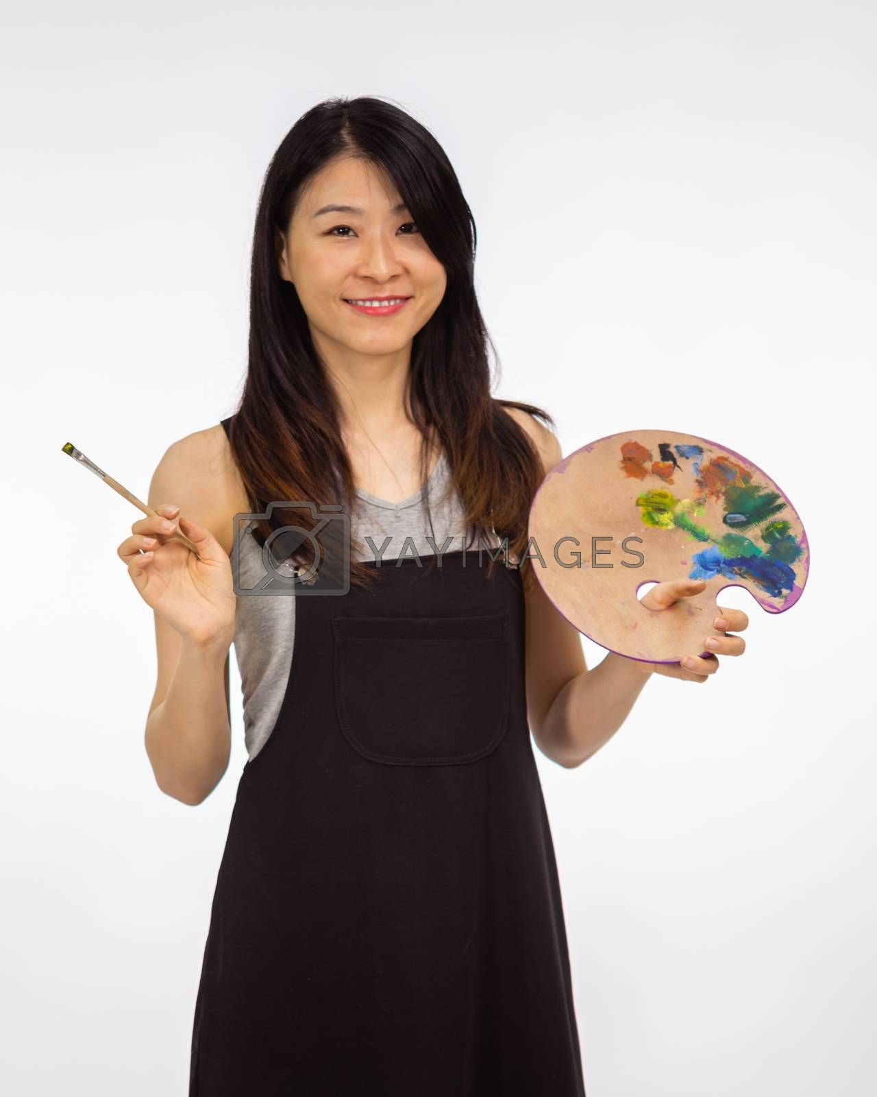 Artist holding painting palette and brush