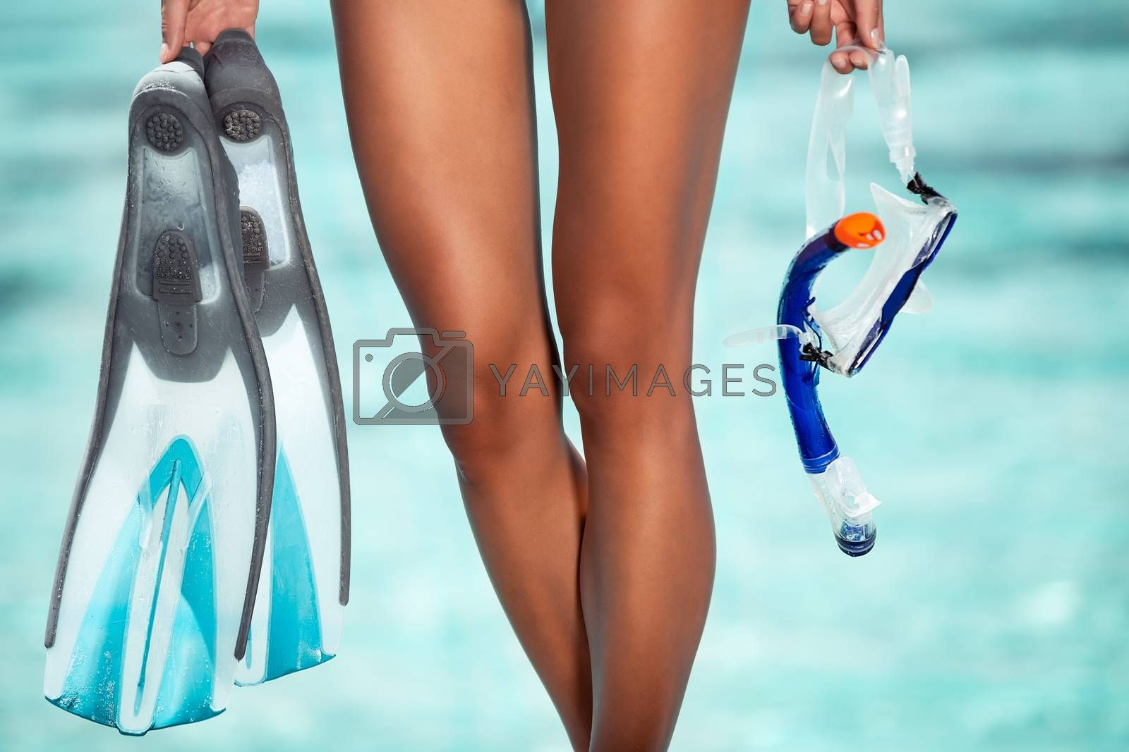 Photo of woman on the beach standing with snorkeling equipment in hands, body part, enjoying water sports, exotic summer vacation, Maldives islands