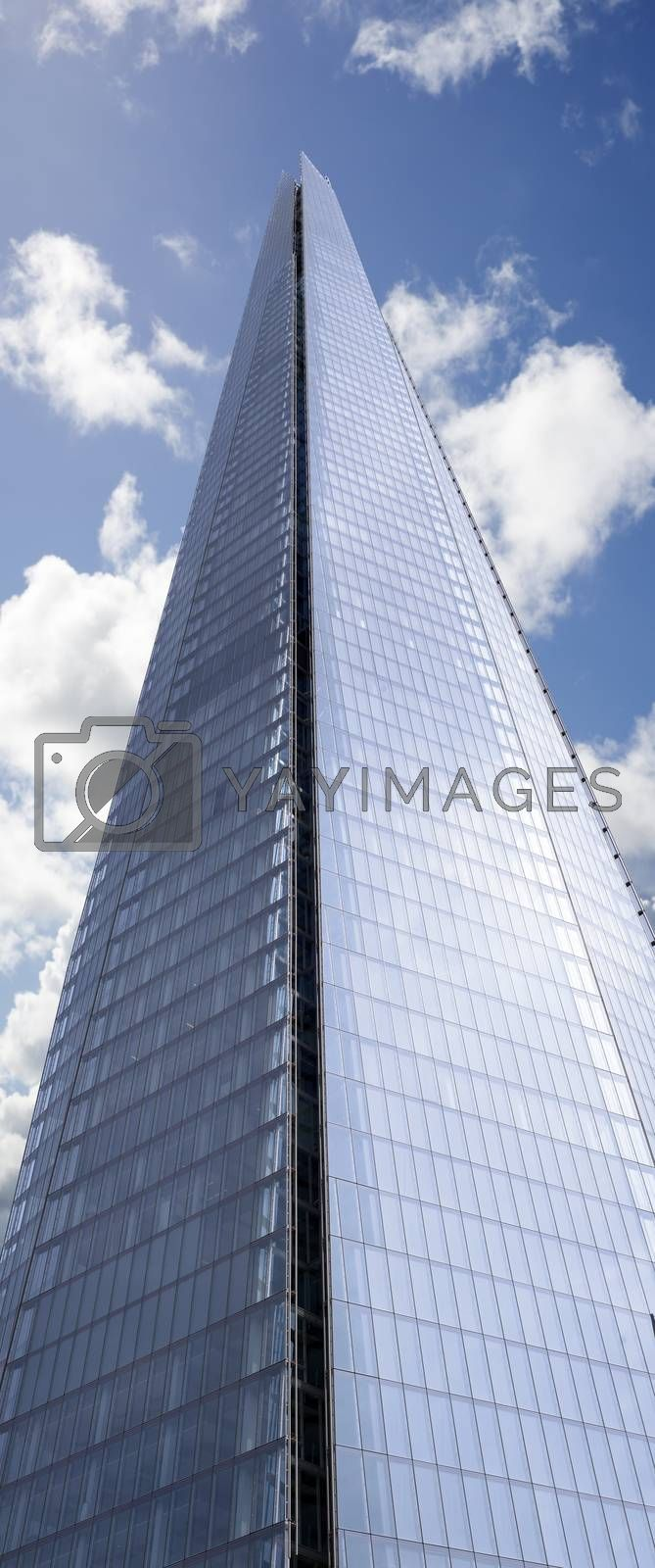 shard skyscraper looming high into the beautiful blue cloudy sky