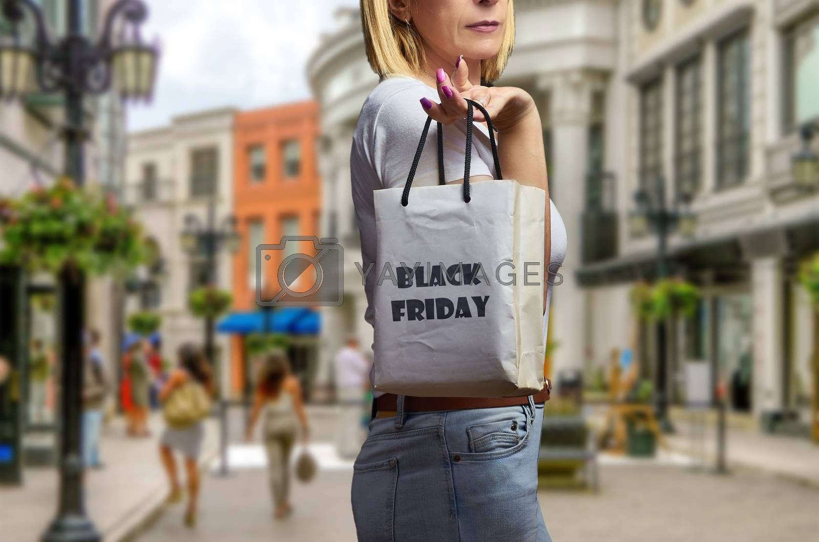 Blond woman in shopping street on black friday
