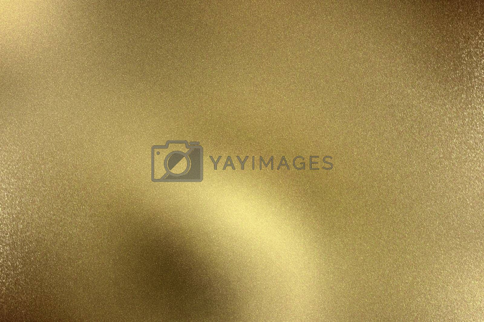 Royalty free image of Glowing gold wave metal plate, abstract texture background by mouu007