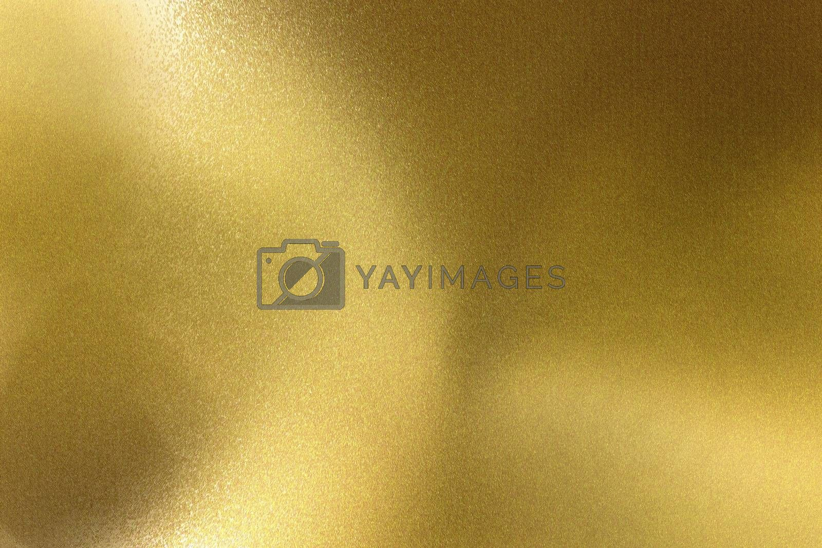 Royalty free image of Light shining on brushed golden wave metal wall, abstract texture background by mouu007