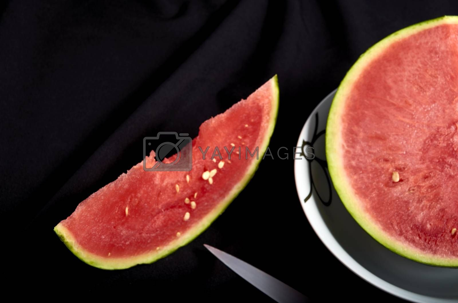Image slice of watermelon with bite black background