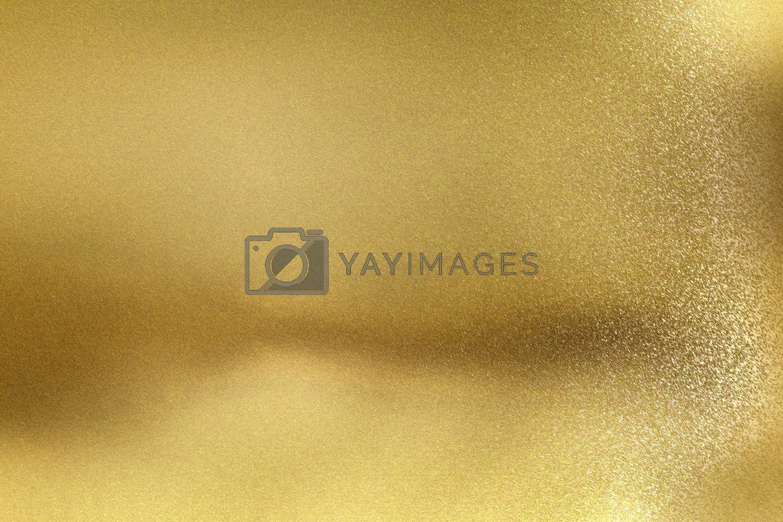 Royalty free image of Glowing golden metal wall with scratched surface, abstract texture background by mouu007