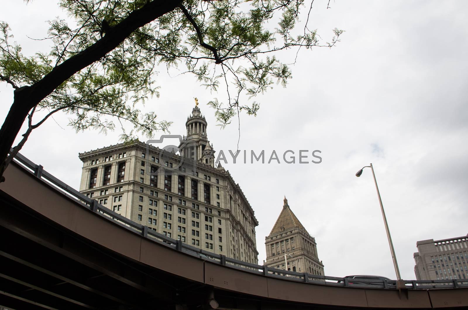 Buildings behind raised freeway bridge in new york city