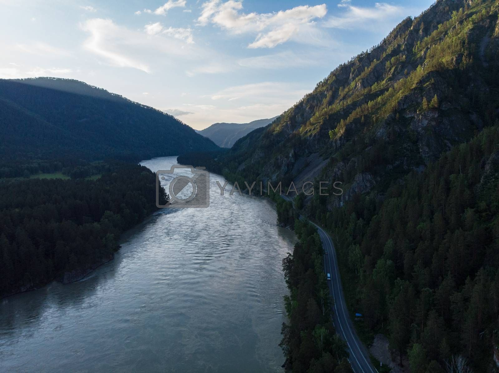 Aerial view of Katun river with road, after sunset in Altai mountains
