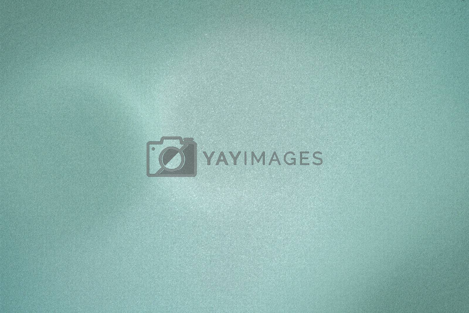 Royalty free image of Glowing green brushed metal wall, abstract texture background by mouu007