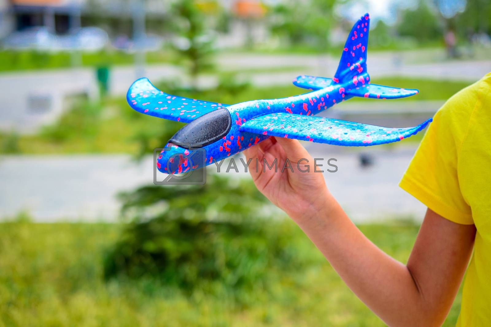 a child plays with a model airplane
