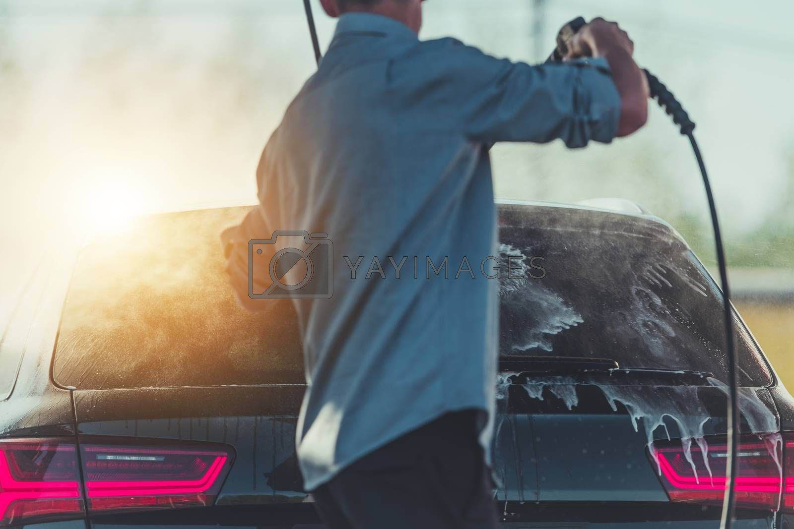 Royalty free image of Men Washing His Car by welcomia