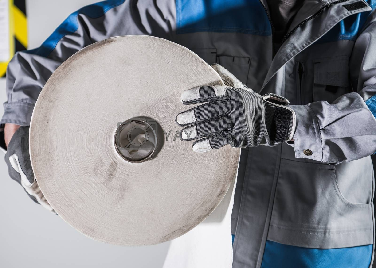 Royalty free image of Worker with Industrial Paper by welcomia