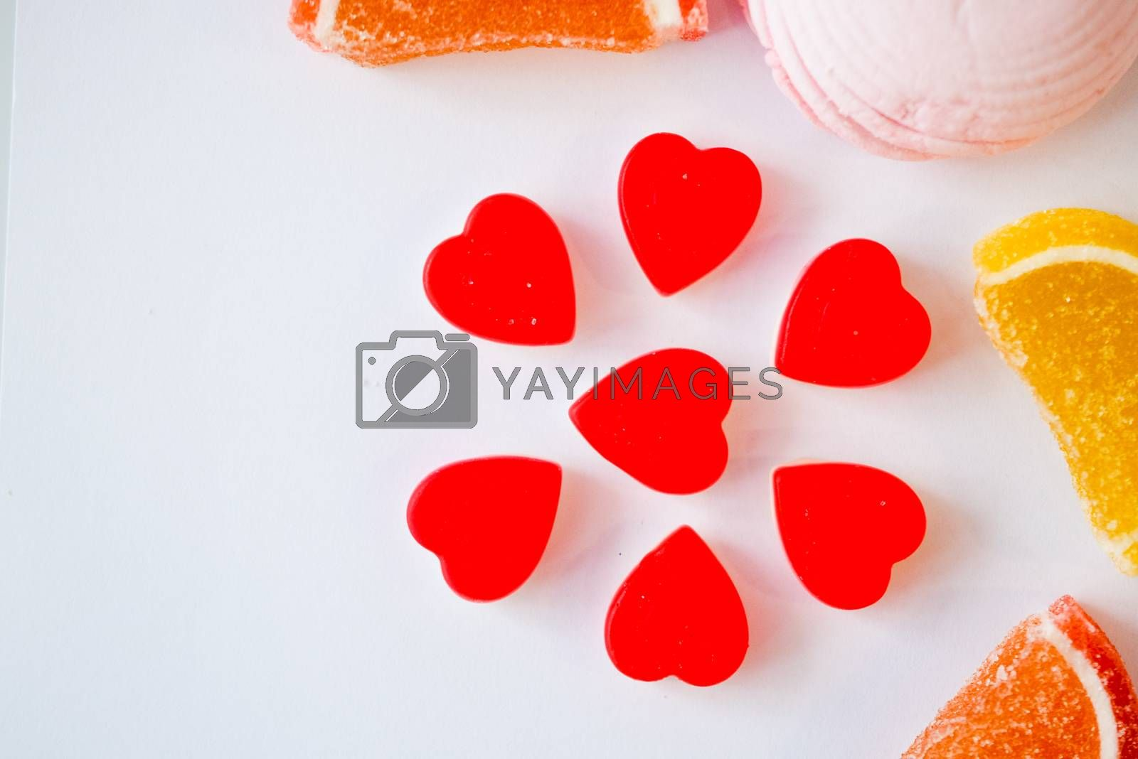 Royalty free image of confectionery - marmalade in the form of a heart and cookies in the form of a flower by alexandr_sorokin