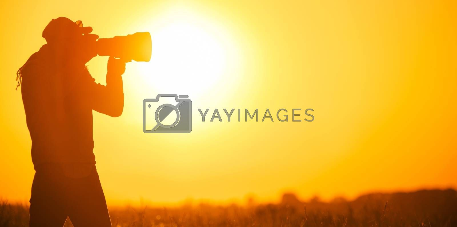 Royalty free image of Photographer Taking Pictures by welcomia