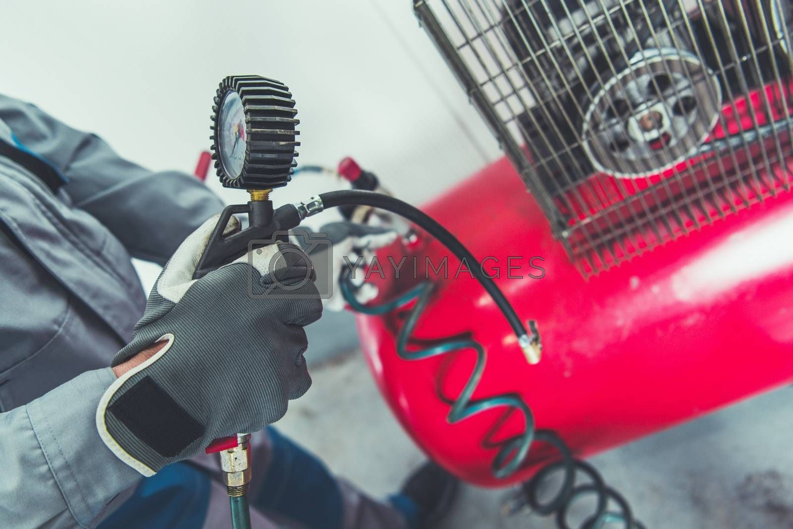 Royalty free image of Garage Air Compressor by welcomia