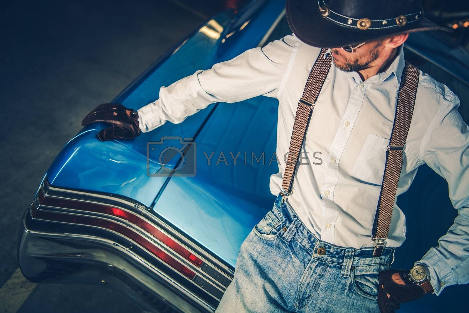 Young Cowboy Driver and His Muscle Classic Car. American Style Driving.