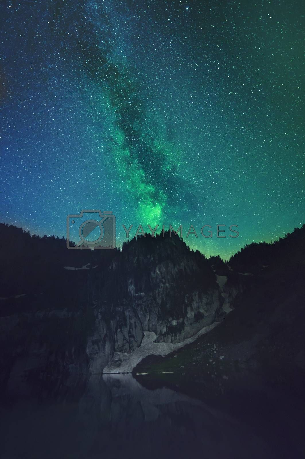 Royalty free image of Galaxy behind glacier mountain by KrisGreer08