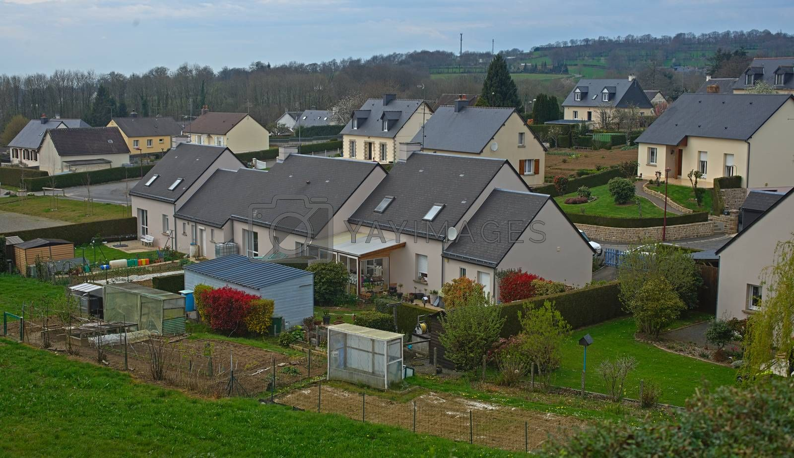 Royalty free image of SOURDEVAL, FRANCE - April 6th 2019 - Houses in the village by sheriffkule