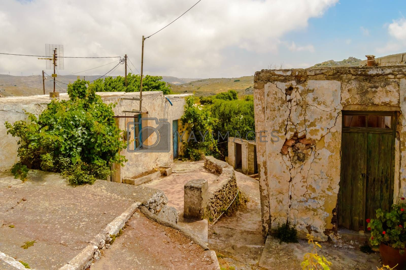 Royalty free image of Old abandoned town. Narrow street in old Greek village. by Philou1000