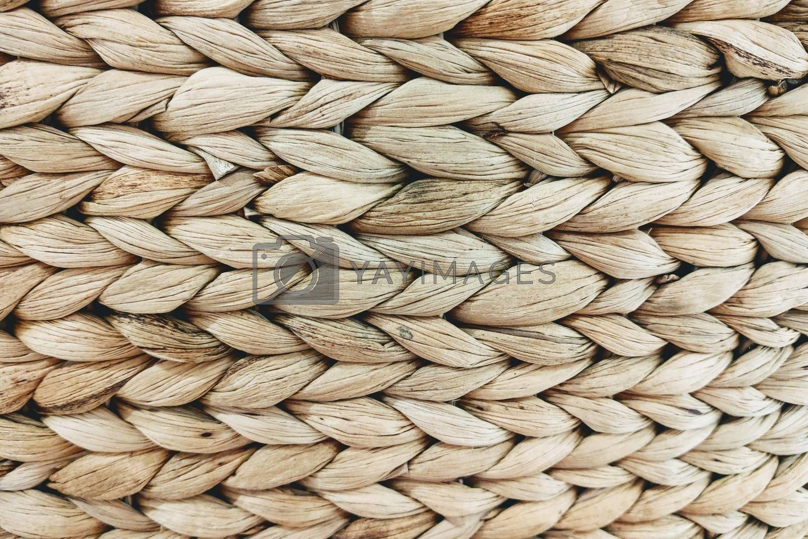 Royalty free image of Abstract decorative wooden textured basket weaving background. by kip02kas