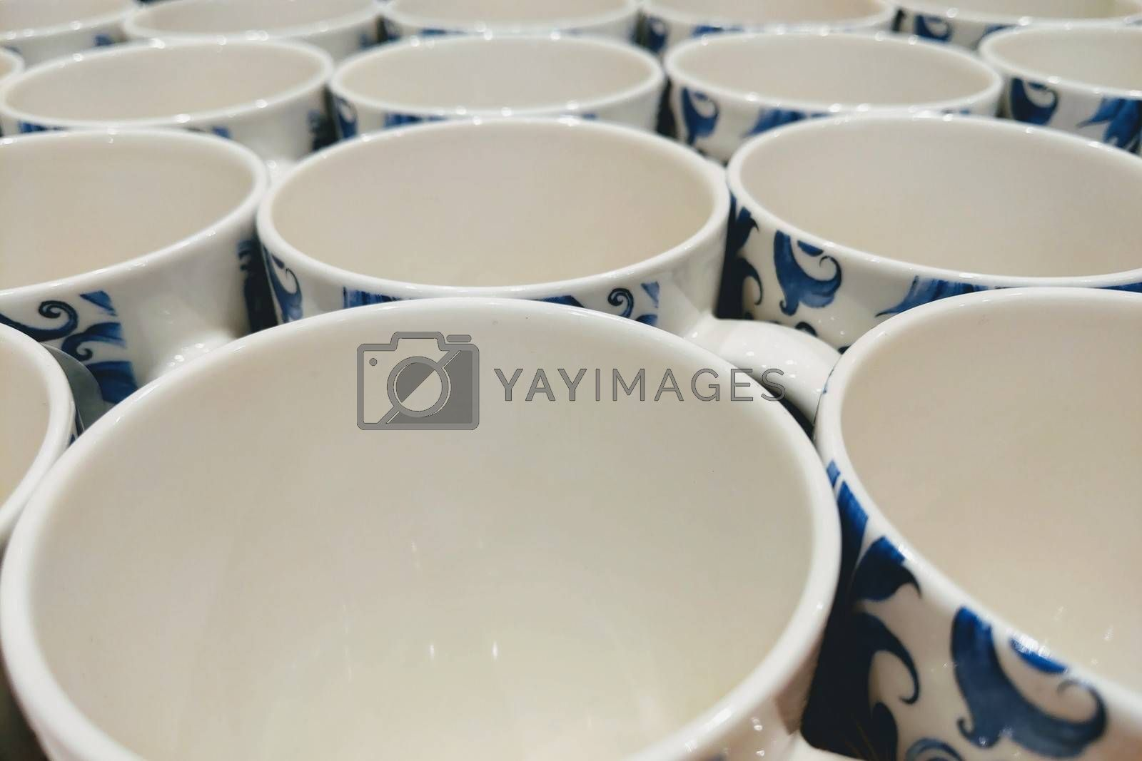 Royalty free image of Colorful mugs on shelf in retailer gift shop. by kip02kas