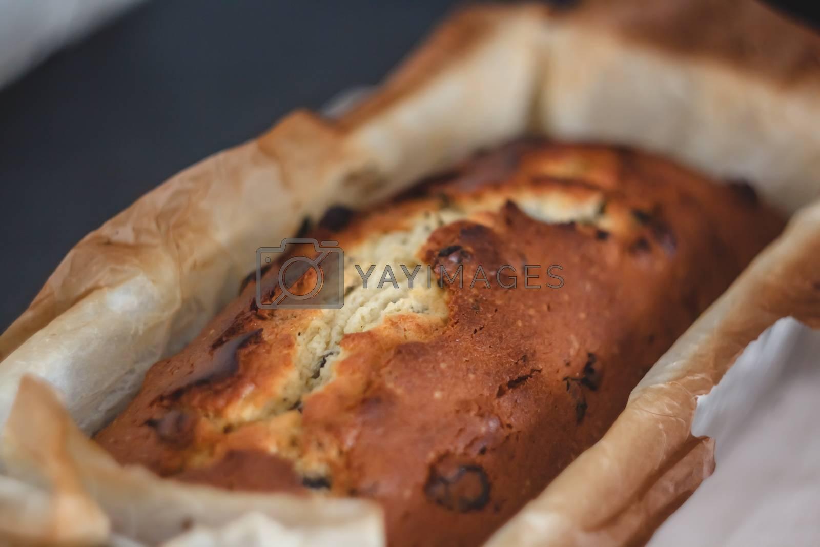 Royalty free image of Rectangular ruddy metropolitan cake-bread in a metallic baking d by Tanacha