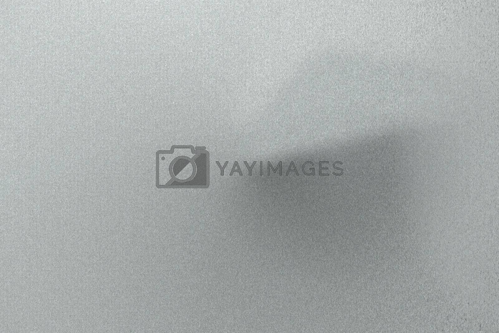 Royalty free image of Brushed light gray wave metallic sheet, abstract texture background by mouu007