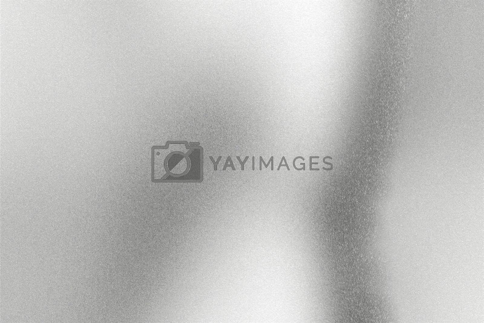 Royalty free image of Light shining on silver wave metal wall, abstract texture background by mouu007